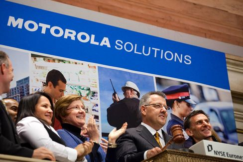 Greg Brown, president and chief executive officer of Motorola Solutions Inc., second from right, rings the closing bell at the New York Stock Exchange in New York on Jan. 4, 2011.