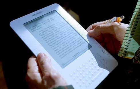 A reporter holds the Amazon Kindle 2.0 on Feb. 9, 2009, in New York