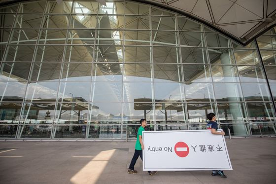 China Likens Protesters to 'Terrorists' as Airport Curbs Access