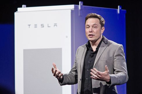 Elon Musk, co-founder and chief executive officer of Tesla Motors Inc., speaks during the unveiling of the company's