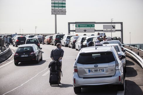 A row of French taxis outside Charles de Gaulle Airport protesting against Uber's ride-hailing service.