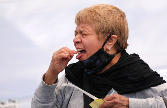 Spit in a Tube or a Swab in the Nose? Saliva Shows Promise in Covid Test Debate