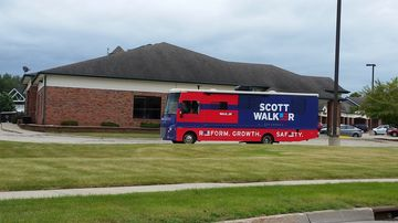 Scott walker's tour bus waits outside an event in ames, iowa, on sat., sept. 20, 2015.