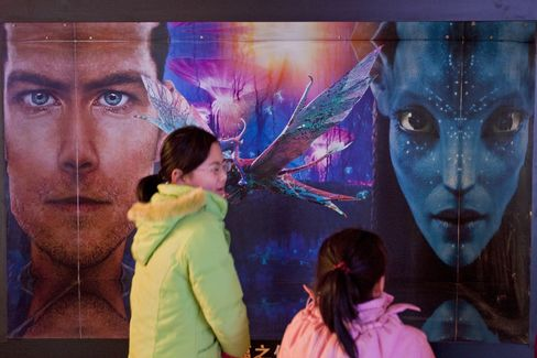 Moviegoers walk past an advertisement for the film