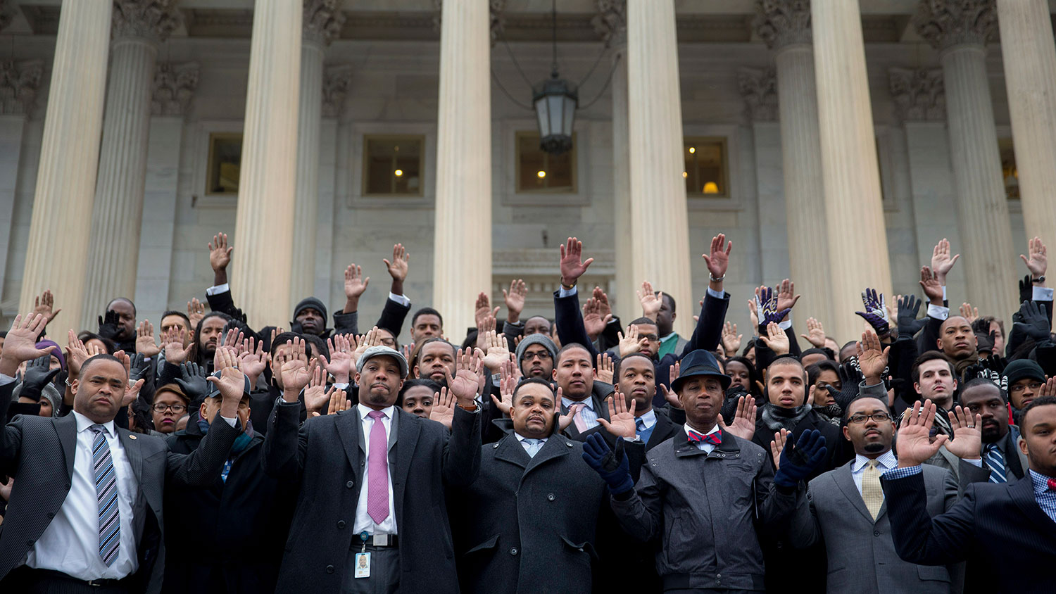 Congressional staff members raise their hands on the U.S. Capitol steps during a protest in Washington on Dec. 11, 2014.