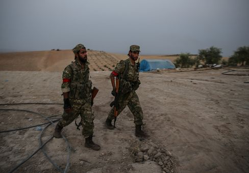 Members of the FSA patrol the Kaklijah village of Jarabulus on Aug. 24.