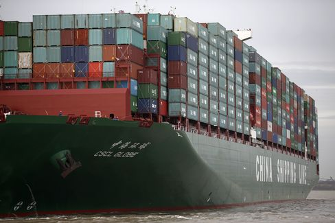 Crew members watch from the deck of the world's largest container ship, the CSCL Globe, operated by China Shipping Container Lines Co., ahead of docking at the Port of Felixstowe, a subsidiary of Hutchison Whampoa Ltd., in Felixstowe, U.K., on Wednesday, Jan. 7, 2015. The inflation rate in the euro area fell below zero for the first time in more than five years, bolstering the case for more European Central Bank stimulus. Photographer: Simon Dawson/Bloomberg