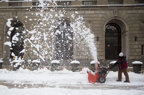 A Worker Uses a Snow Blower in Washington