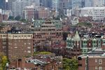 Brownstone buildings are seen from a rooftop near Kenmore Square in Boston, Massachusetts, U.S.,