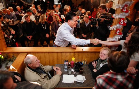 Mitt Romney greets supporters during a campaign event on Dec. 29, 2011, in Cedar Falls, Iowa.