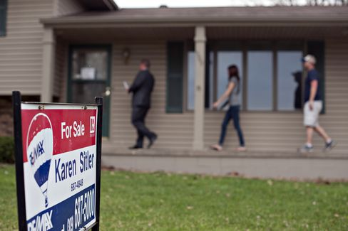 Potential Home Buyers View a Home in Washington