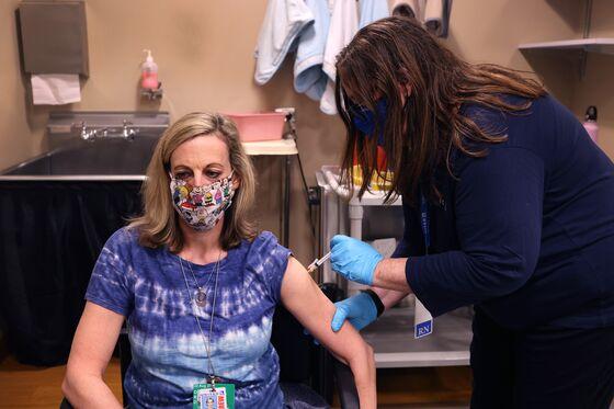 No Vaccine, No Desk: Firms Weigh Whether to Make Shots Mandatory
