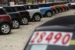 Bayerische Motoren Werke AG Mini vehicles are displayed for sale at a car dealership in Louisville, Kentucky