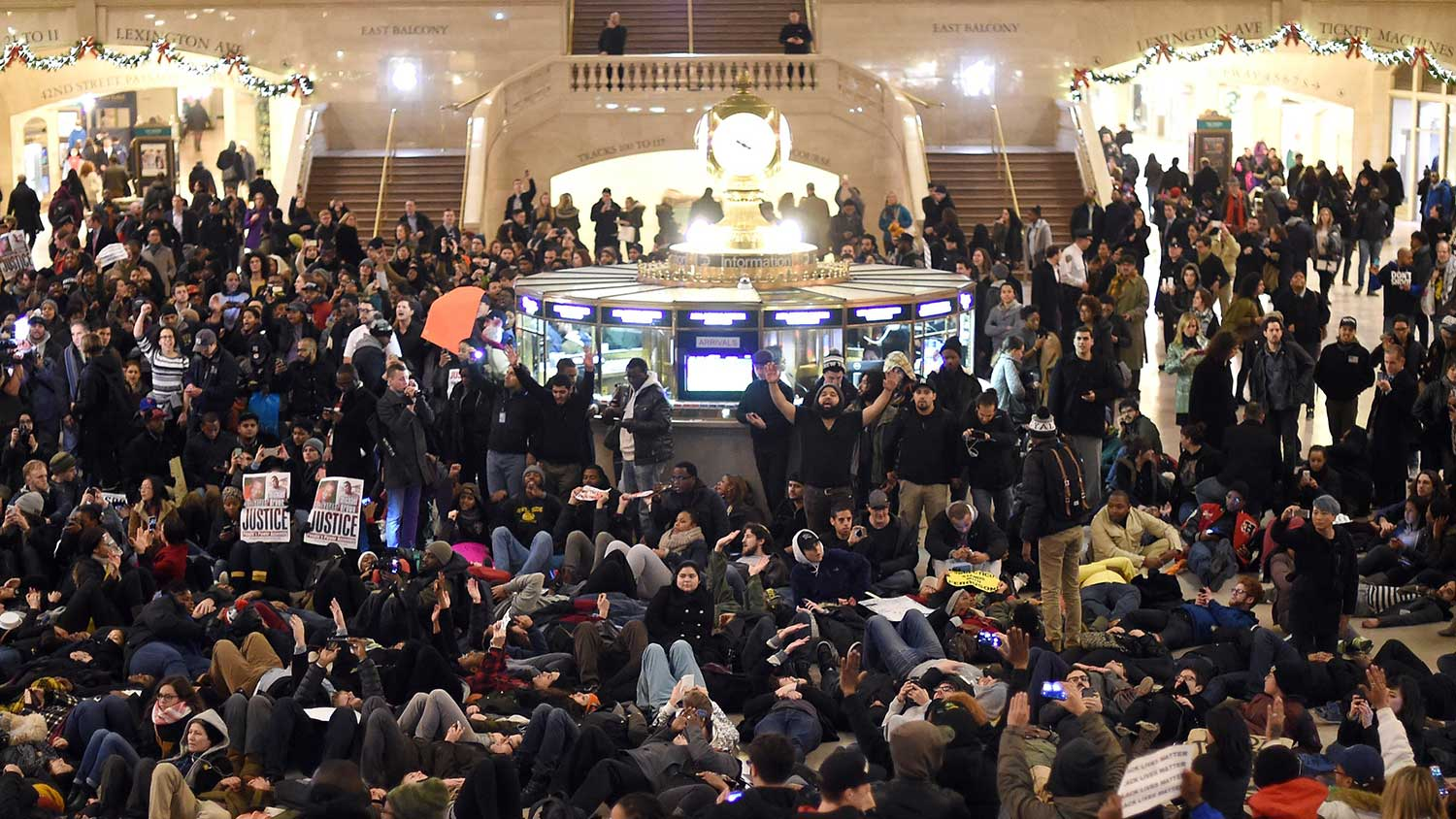 Protestors lay down in New York's Grand Central Station during a protest against the grand jury's decision on Dec. 3, 2014.