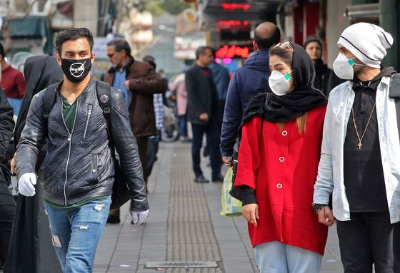 Iran Battles to Contain Panic AfterVirus Deaths Multiply