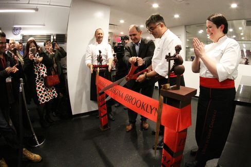 Jean-Luc Grisot and Frédéric Bau cut the ribbon at Valrhona's grand opening in Brooklyn.