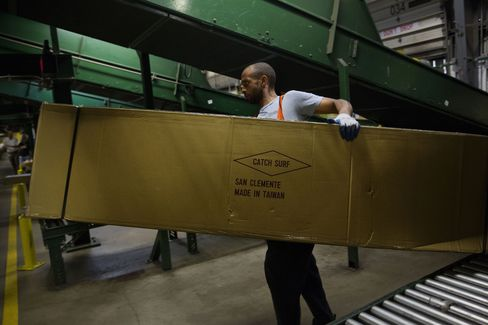 An employee unloads an oversized package at a FedEx Corp. Ground distribution center.