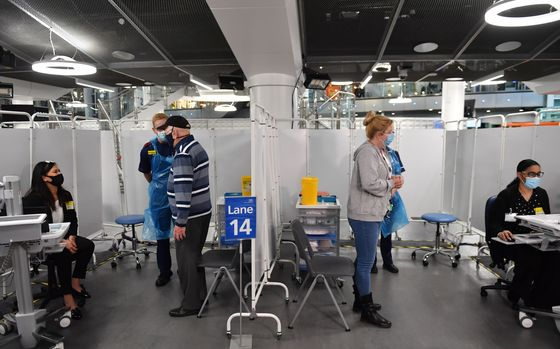 Besieged U.K. Hospitals Offer a Warning on Lagging Covid Vaccines
