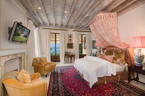 The master bedroom at Kilkee House features a fireplace for the rare night in the Bahamas when the temperature drops below 70F, a welcome addition in a country where even the most luxurious homes rarely haveheat.