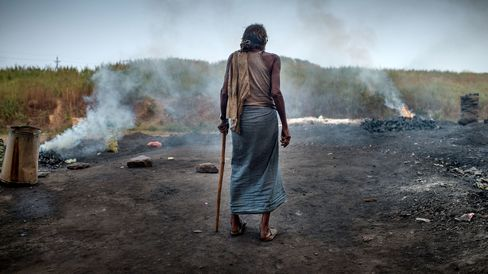 A villagenear the coal mines of Jharia, India, where methane and other toxic gases spew from open wounds in the earth's crust.