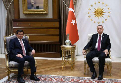 Recep Tayyip Erdogan, right, and Ahmet Davutog