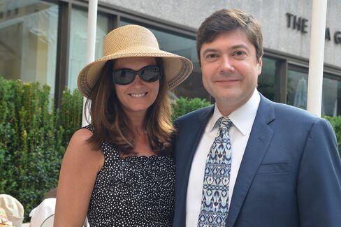 Eva Dillon, in an Eric Javits sun hat, and Brendan Dillon of UBS. Photographer: Amanda Gordon/Bloomberg