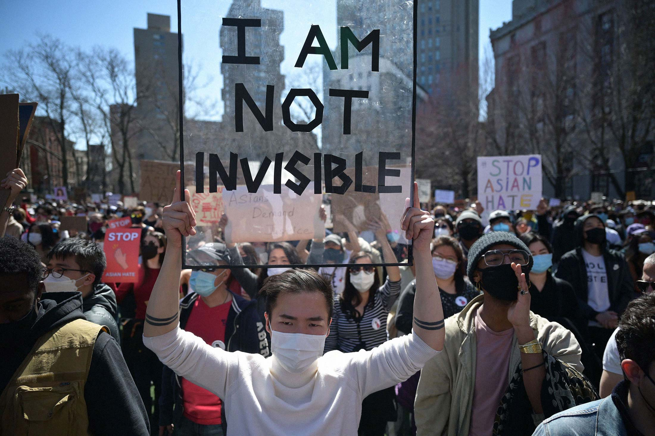 """Members and supporters of the Asian American community attend a """"rally against hate"""" at Columbus Park in New York on March 21."""