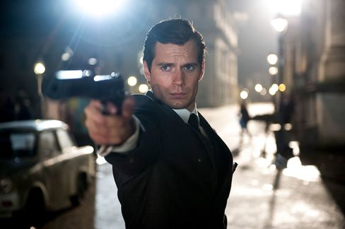 Cavill's Napoleon Solo is a sure shot—in a Timothy Everest two-piece suit.