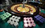 Gaming chips sit around a roulette wheel at the Japan Casino School in Tokyo, Japan.