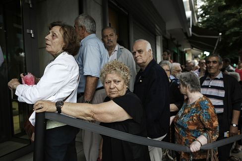 Pensioners queue at a bank branch in Thessaloniki today