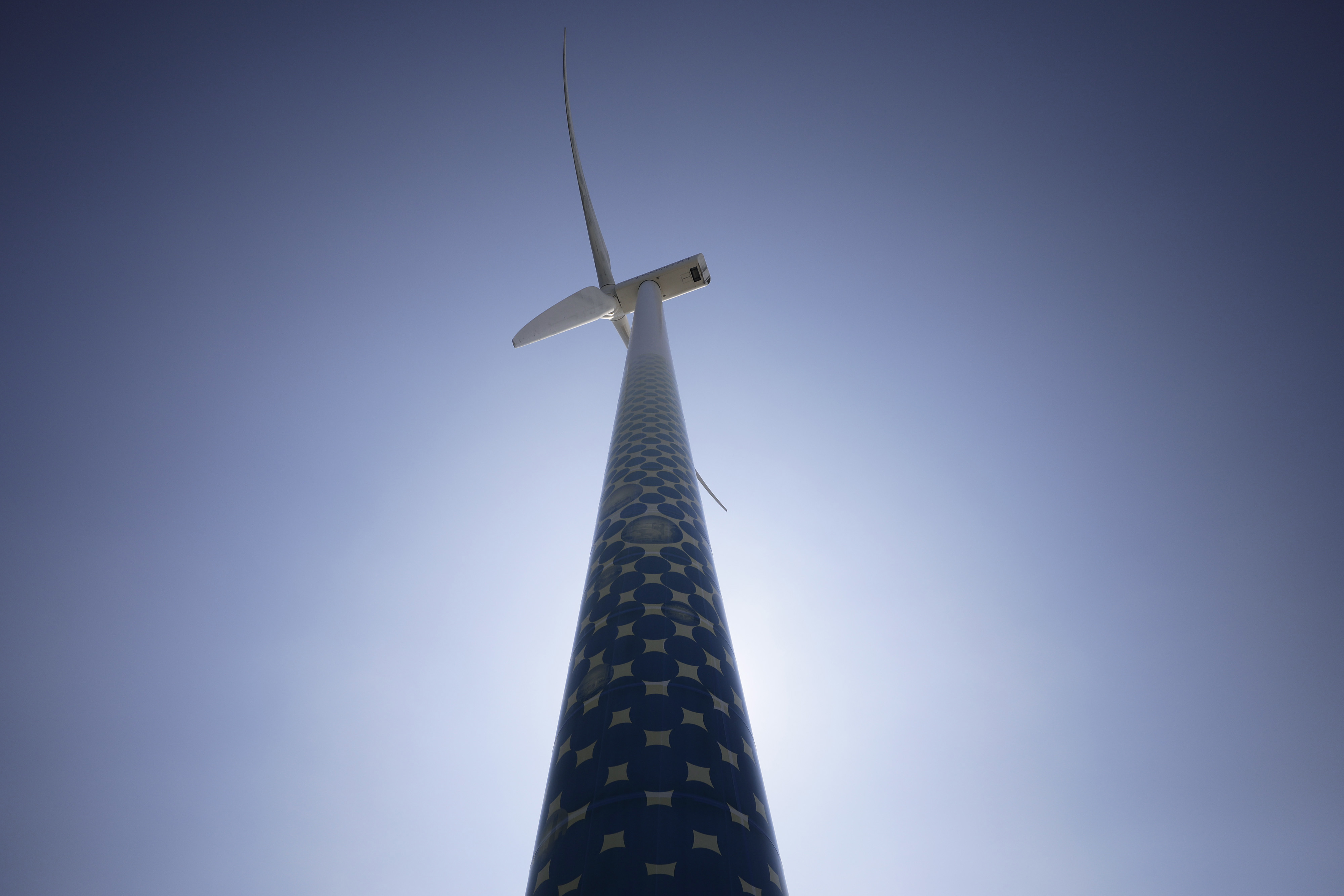 A wind turbine operates at a wind power plant during a demonstration of a hydrogen supply chain system in Yokohama, Japan.