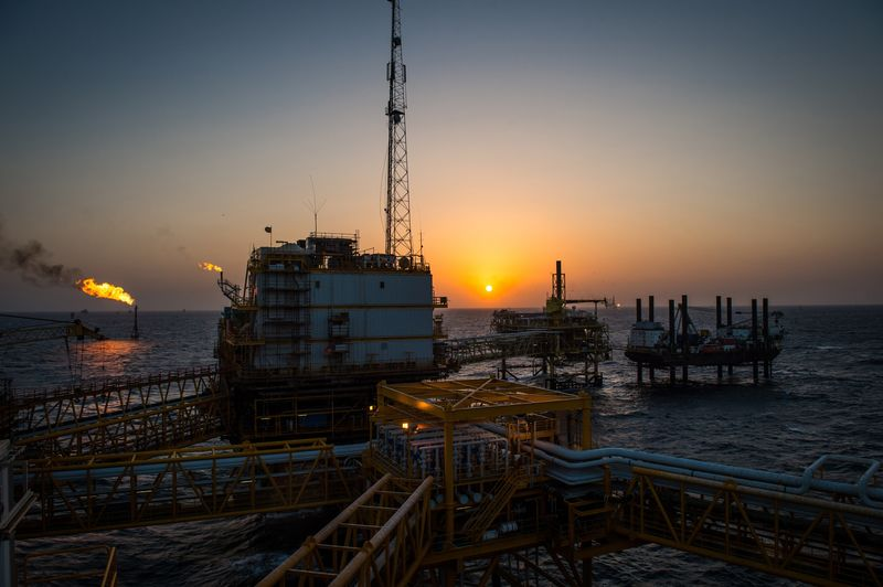 Gas flares burn from pipes aboard an offshore oil platform in the Persian Gulf's Salman Oil Field, operated by the National Iranian Offshore Oil Co.