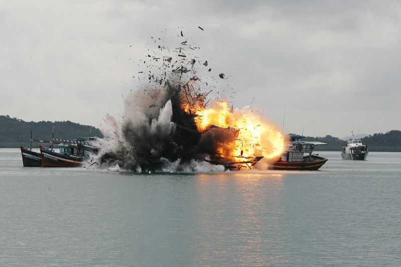 Indonesian Navy blows up 6 foreign fishing vessel caught fishing illegally in Batam. Image:  Sijori Images/Barcroft Media via Getty Images