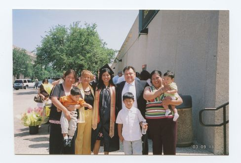 With extended family at her college graduation in 2005.