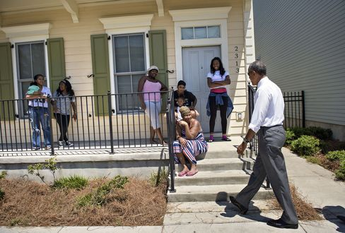 Residents watch as US President Barack Obama walks during a tour of the Treme neighborhood in New Orleans, Louisiana on Thursday.