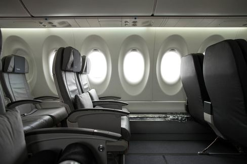 Passenger seating and windows sit inside the new Bombardier CS100 C Series aircraft.
