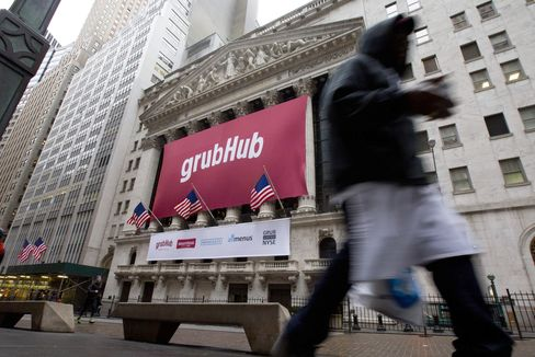 A GrubHub Inc. Banner Sits Outside the New York Stock Exchange