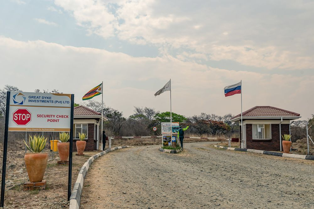 A security guard stands at the entrance gates of the Great Dyke Investments project in Zimbabwe.