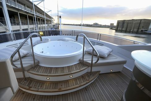 A Jacuzzi sits on the upper deck of a Sunseeker 131 yacht that was on display at the 2016 London Boat Show.
