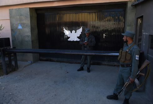 Police Stand Guard Outside Park Palace Guesthouse in Kabul
