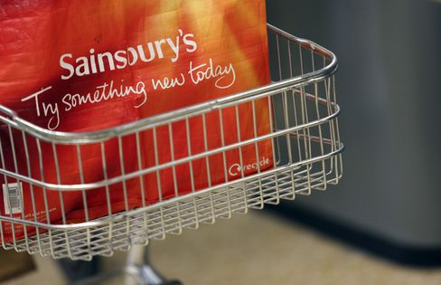 A Sainsbury's Shopping Bag Sits in a Cart in a Store