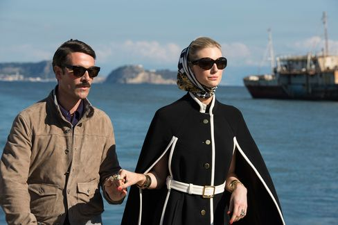 In Persol shades and a Massimo Rebecchi leather jacket, Alexander leads an on-point Victoria to their Riva boat.