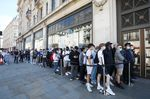 Customers stand in line to enter the Niketown store, operated by Nike Inc., in London, U.K.