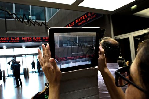 The stock price ticker screen is filmed following the reopening of the Athens Stock Exchange in Athens, on Aug. 3, 2015.