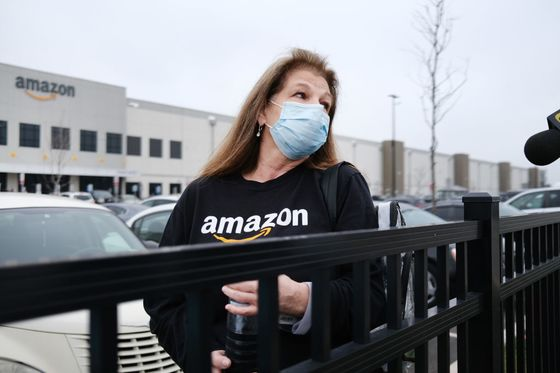 Amazon Workers Sue Over Virus Brought Home from Warehouse