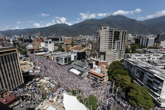 Venezuelans March as Guaido and Maduro Vie for Legitimacy
