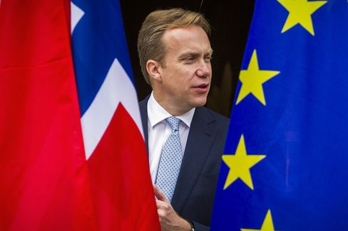 Norwegian foreign minister Boerge Brende is seen between the Norwegian (L) and EU flag on his arrival for a meeting with German foreign minister at the foreign ministry's Villa Borsig at lake Tegel in Berlin October 17, 2014. AFP PHOTO / ODD ANDERSEN (Photo credit should read ODD ANDERSEN/AFP/Getty Images)