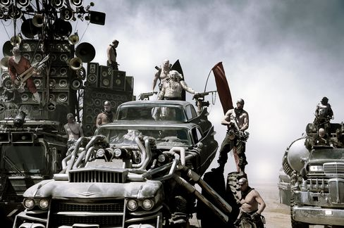 "The ""sonic carmageddon"" of the Doof Wagon (left) accompanies Immortan Joe's Gigahorse—a Siamese twin of two 1959 Cadillac Devilles on stereoids—in hot pursuit across the desert."