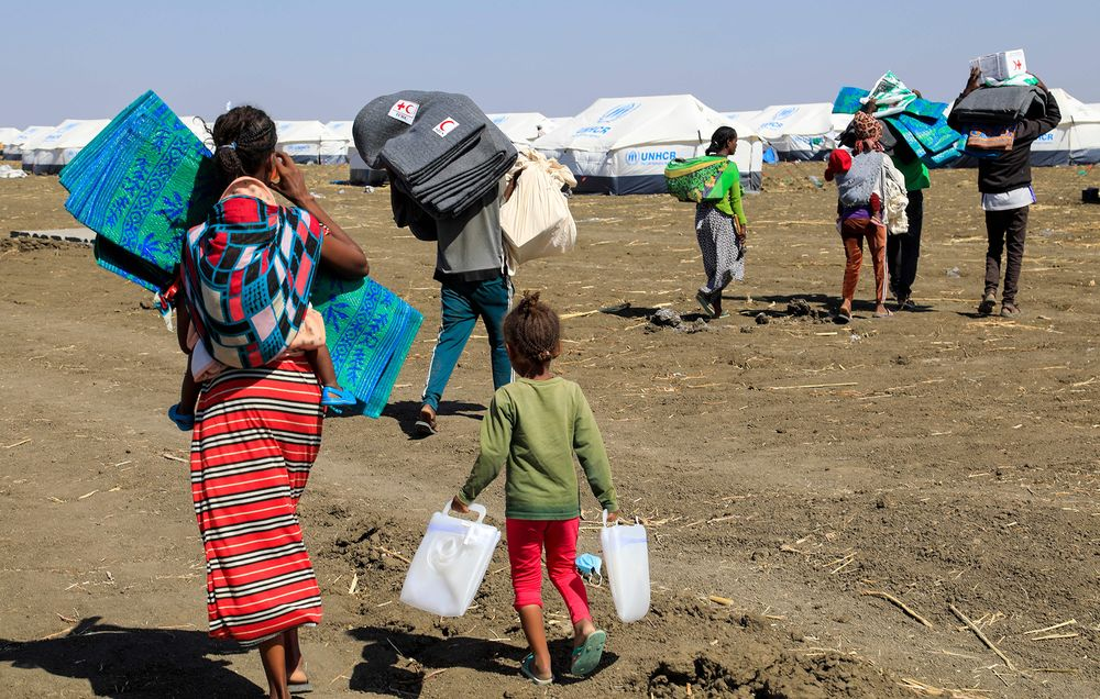 Ethiopian refugees, who fled the Tigray conflict, upon arrival at the Tenedba camp in Mafaza, eastern Sudan on Jan.8.