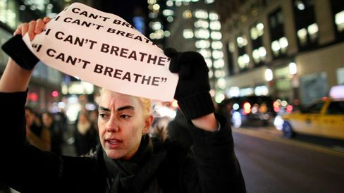 Demonstrators walk together during a protest against the grand jury's decision on Dec. 3, 2014, in New York.